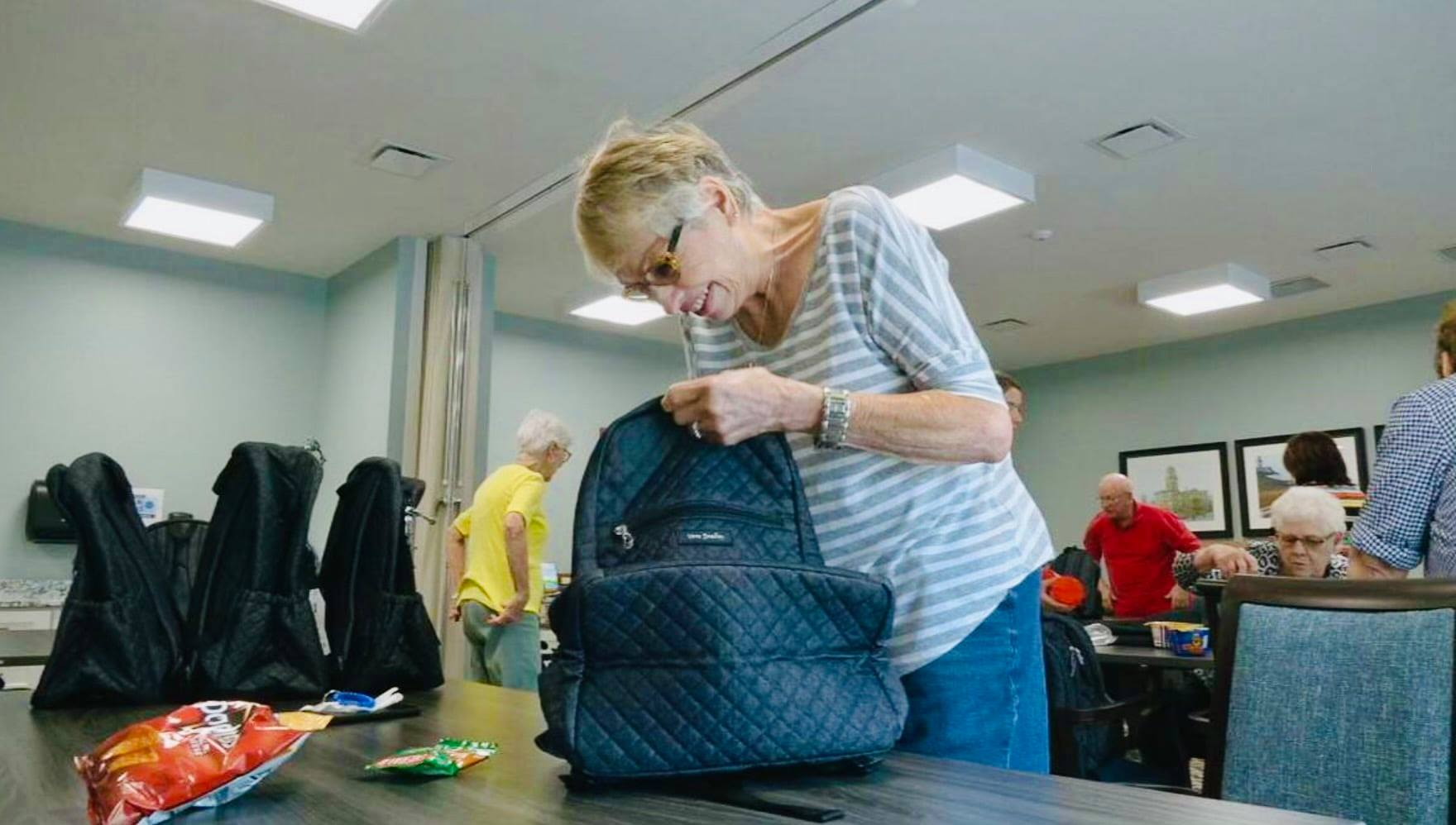 Seniors fill backpacks for children facing food insecurity